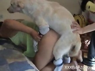 Guy helps his dog hump beautiful young female from behind